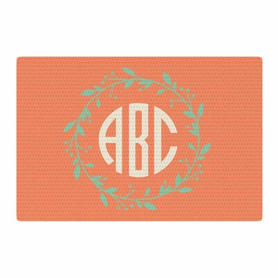 Classic Wreath Monogram Illustration Green/Orange Area Rug Rug Size: 4 x 6
