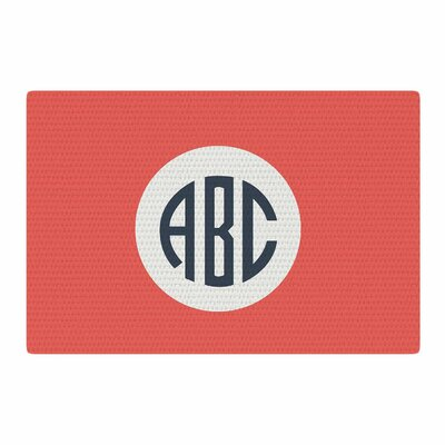 Classic Circle Monogram Digital Illustration Red Area Rug Rug Size: 4 x 6