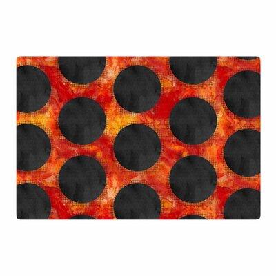 Zara Martina Mansen Volcanic Black Holes Polkadot Red Area Rug Rug size: 2 x 3
