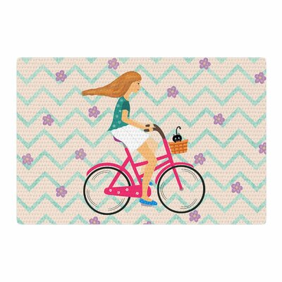 Cristina Bianco Design Bicycle Ride Pink/Black Area Rug Rug Size: 4 x 6