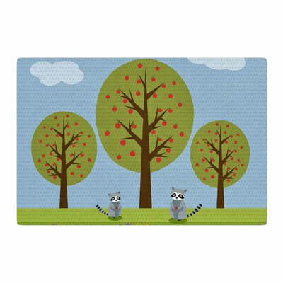 Cristina Bianco Design Cute Raccoons And Apple Trees Illustration Green/Blue Area Rug Rug Size: 2 x 3