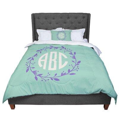 Classic Wreath Monogram Typography Comforter Size: King, Color: Blue/Purple