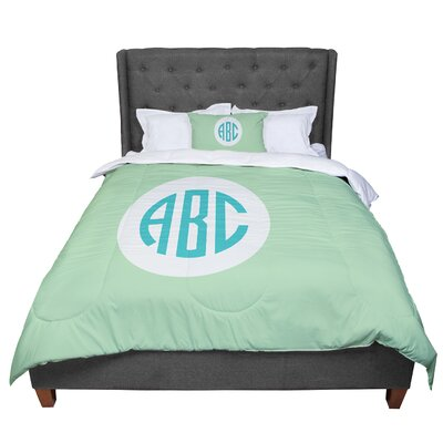 Classic Circle Monogram Digital Illustration Comforter Size: King, Color: Green/Teal