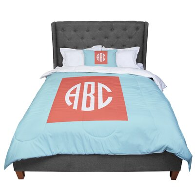 Classic Circle Monogram Digital Illustration Comforter Size: Queen, Color: Orange/Blue