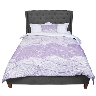 Pom Graphic Design The Lavender Seas Waves Comforter Size: Queen