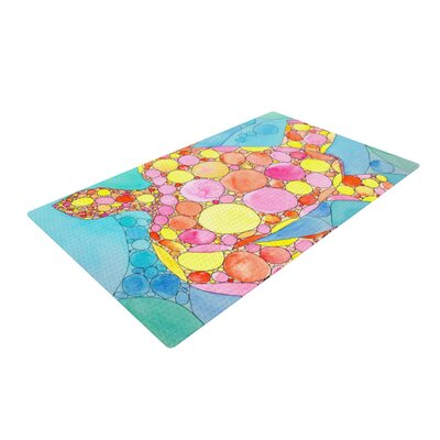 Catherine Holcombe Circle Turtle Yellow/Orange Area Rug Rug Size: 2 x 3