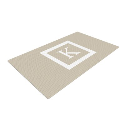 Monogram Solid Tan Area Rug
