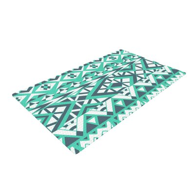Pom Graphic Design Tribal Simplicity Teal Area Rug Rug Size: 4 x 6
