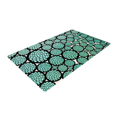 Pom Graphic Design Blooming Trees Circles Turquoise Area Rug Rug Size: 2 x 3