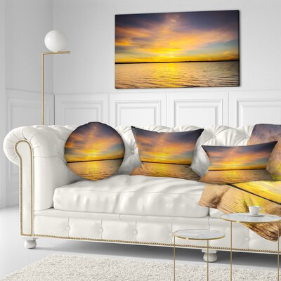 Sunrise Light Hitting Water Seashore Throw Pillow Size: 16 x 16