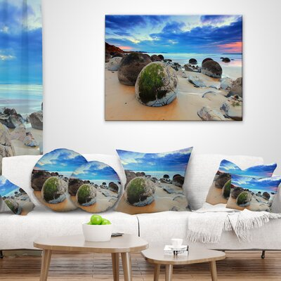 Cloudy Sunrise over Moeraki Boulders Seashore Photo Throw Pillow Size: 16 x 16