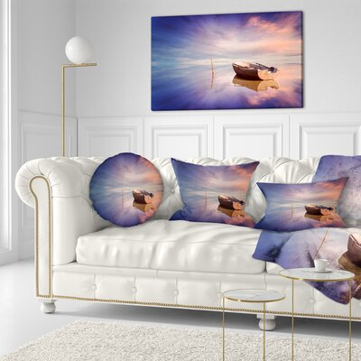Lonely Boat in Sea Seascape Throw Pillow Size: 16 x 16