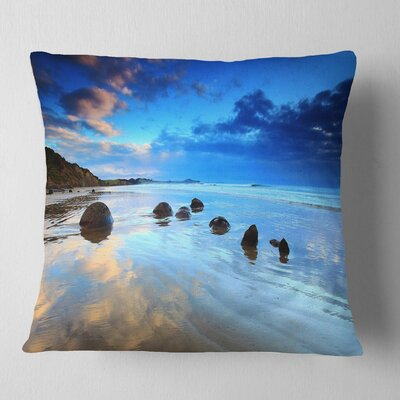Moeraki Boulders Under Cloudy Sky Seashore Photo Pillow Size: 16 x 16, Product Type: Throw Pillow