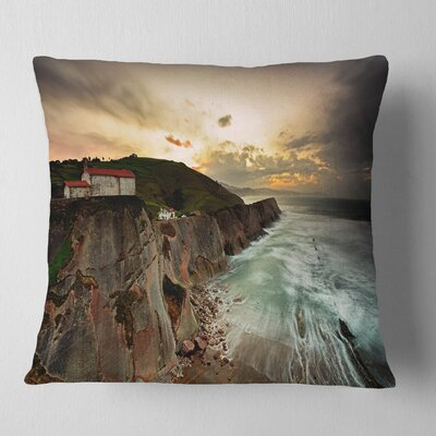 Ocean Hitting Rocky Hill Seashore Photo Pillow Size: 16 x 16, Product Type: Throw Pillow