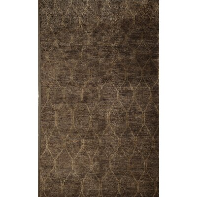 Tindivanam Hand-Woven Brown Area Rug Rug Size: 7 x 9