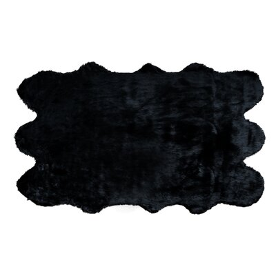 Shag and flokati Faux Sheepskin Black Area Rug Rug Size: 5 x 8