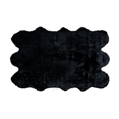 Shag and flokati Faux Sheepskin Black Area Rug Rug Size: 5 x 7