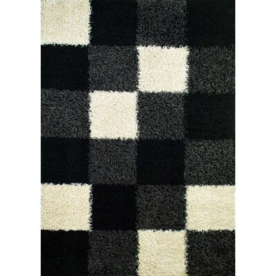 Shaggy Blocks Black Area Rug Rug Size: 67 x 93