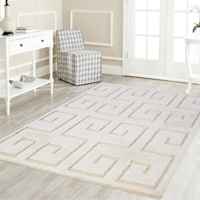 Artz Rectangle White/Beige Area Rug Size: 5 x 8
