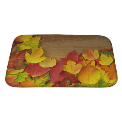 Leaves Autumn with Colored Leaves on Wooden Board Bath Rug Size: Large
