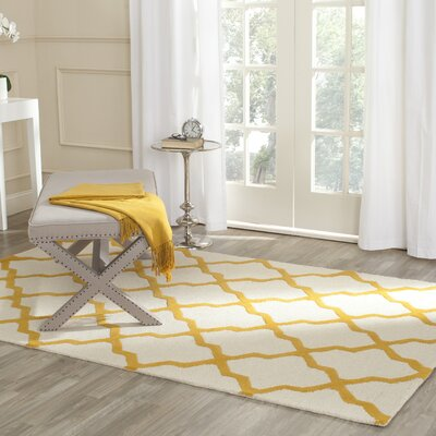 Charlenne Hand-Tufted Ivory/Gold Area Rug Rug Size: Rectangle 26 x 4