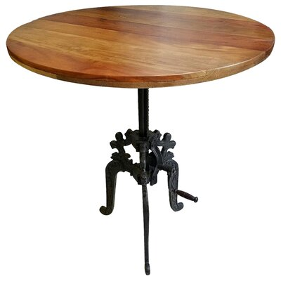 Alvie Round Carved Iron Base Crank Dining Table