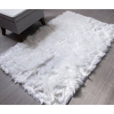 Charlotte Hand-Woven Faux Sheepskin Ivory Area Rug Rug Size: 5 x 7