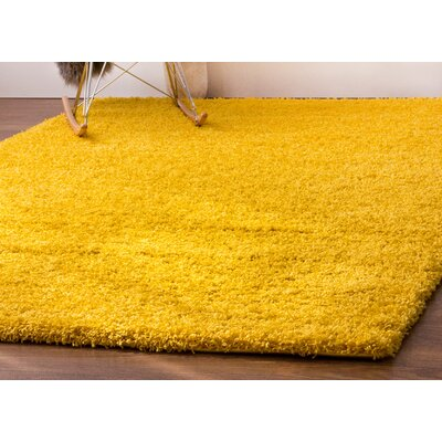 Hasse Plush Solid Yellow Area Rug
