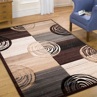 Circles Hand-Woven Chocolate Area Rug Rug Size: Rectangle 79 x 105