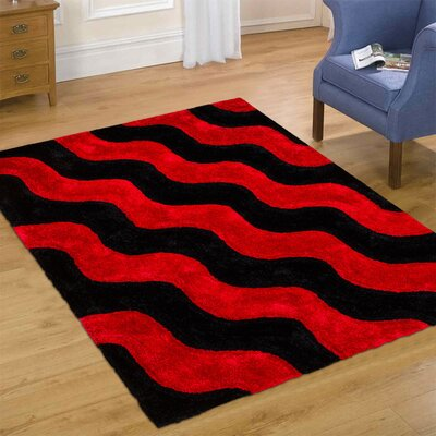 Hand-Tufted Lava/Black Area Rug Rug Size: 76 x 105