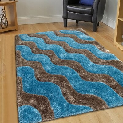 Hand-Tufted Blue/Brown Area Rug Rug Size: 76 x 105