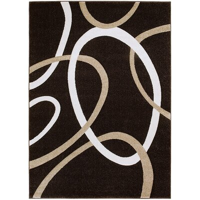 Circle Chocolate Area Rug Rug Size: Rectangle 79 x 105
