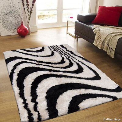 Hand-Tufted Black/Ivory Area Rug Rug Size: 4'11