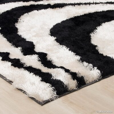 Hand-Tufted Black/Ivory Area Rug Rug Size: 711 x 105
