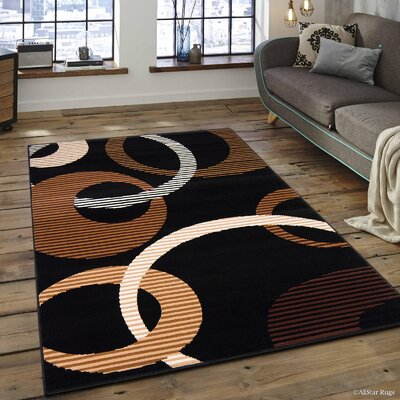 Hand-Woven Black/Brown Area Rug Rug Size: 77 x 106