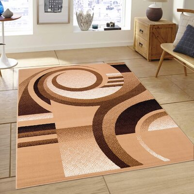 Hand-Woven Brown Area Rug Rug Size: 77 x 106