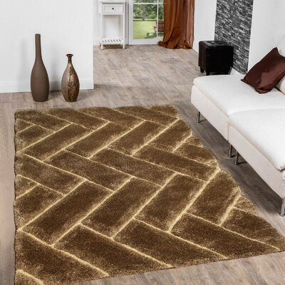 Hand-Tufted Brown Area Rug Rug Size: 76 x 105