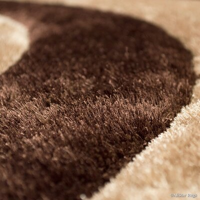 Hand-Tufted Black/Brown Area Rug Rug Size: 5 x 7