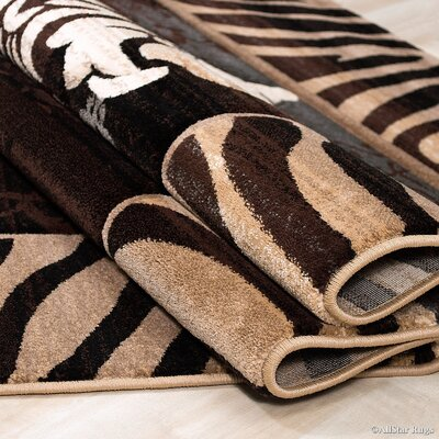 Hand-Woven Brown Area Rug Rug Size: 79 x 105