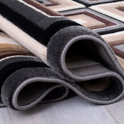Hand-Tufted Brown Area Rug Rug Size: 52 x 72