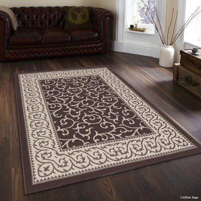 Morales All-Weather Floral Chocolate Indoor/Outdoor Area Rug Rug Size: 5 x 7