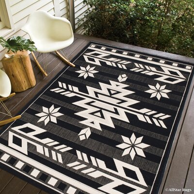 Ilana All Weather Indoor/Outdoor Black Area Rug Rug Size: 5 x 7