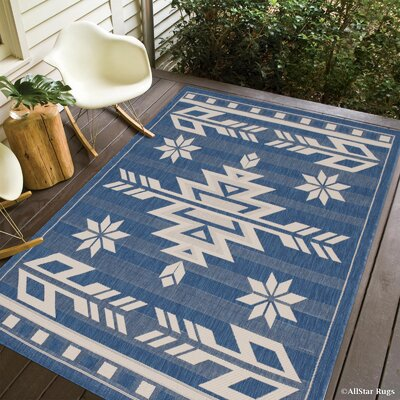Ilana All Weather Indoor/Outdoor Navy Area Rug Rug Size: 5 x 7
