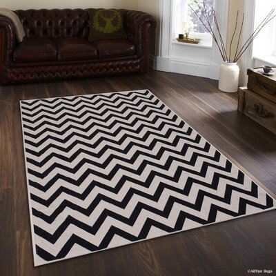 Ernest Black Indoor/Outdoor Area Rug Rug Size: 5 x 7