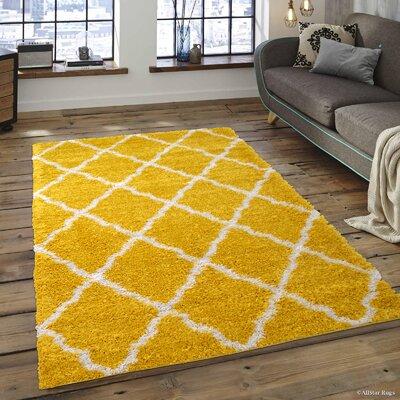 Kavanagh High-Pile Posh Shaggy Canary Area Rug Rug Size: 5 x 7