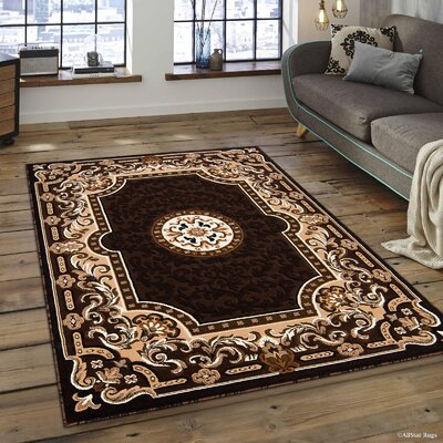 Berwick Floral Bordered Chocolate Area Rug Rug Size: 52 x 72