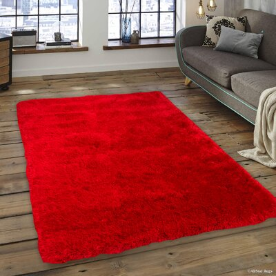 Kearns Faux Sheepskin Red Area Rug Rug Size: 76 x 102