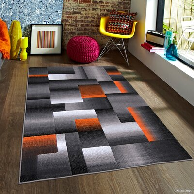 Hutchinson Orange Area Rug Rug Size: 710 x 10