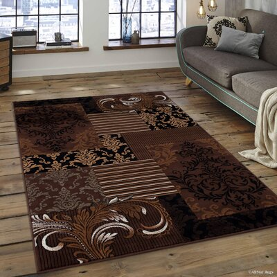 Butler High-Quality Floral Designed Chocolate Area Rug Rug Size: 710 x 10