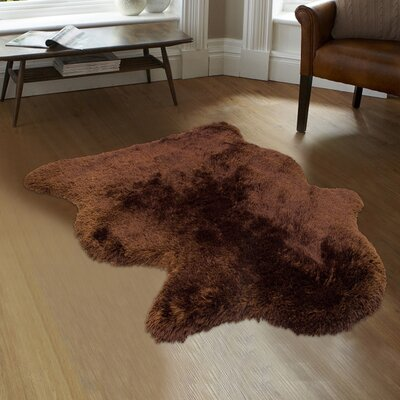 Hand-Tufted Faux Sheepskin Chocolate Area Rug Rug Size: Rectangle 8 x 11